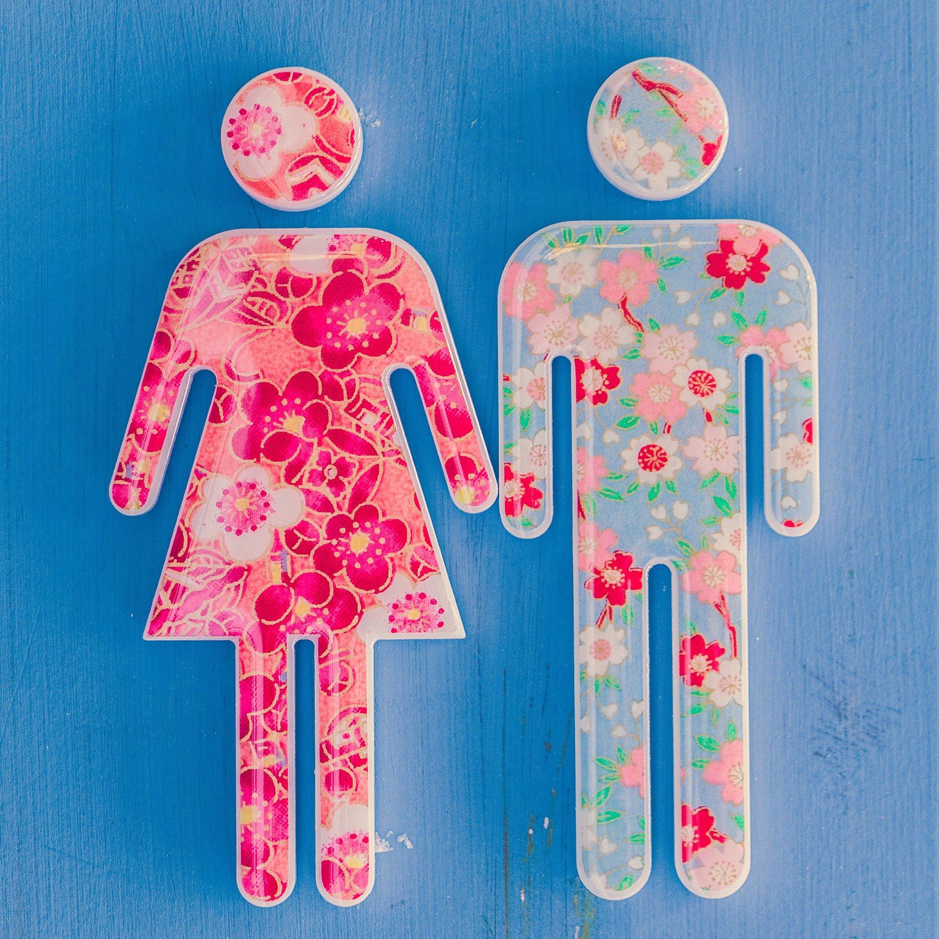 omini stilizzati della toilette colorati