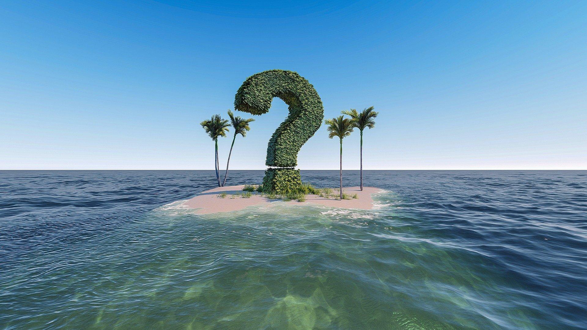 un'isola con alcune palme ue una vegetazione a disegnare un punto di domanda enorme