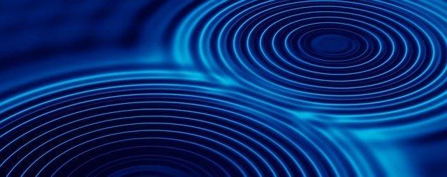 Due onde si intersecano, come l'incontro tra due realtà che si uniscono
